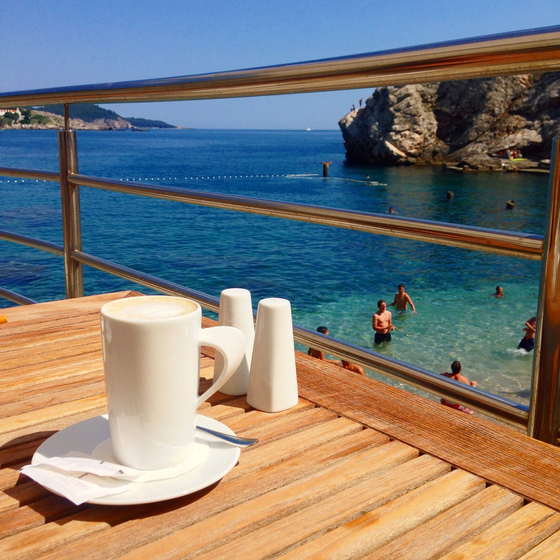 People in Dubrovnik eat and drink coffee outdoors - go dubrovnik