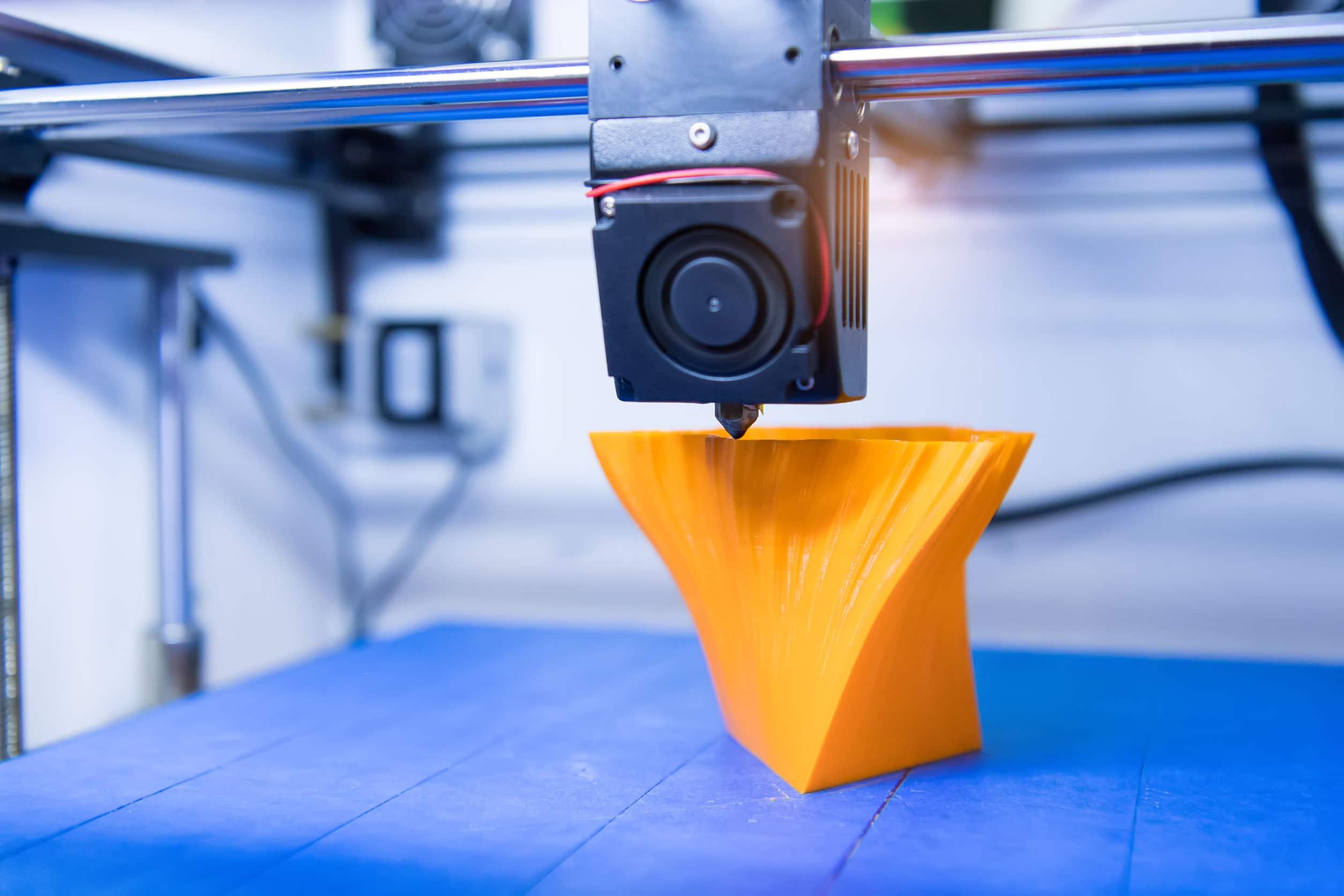 3D printer printing figure close-up macro