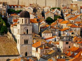 franciscan monastery and museum in the background of roofs with tiles in dubrovnik, croatia.