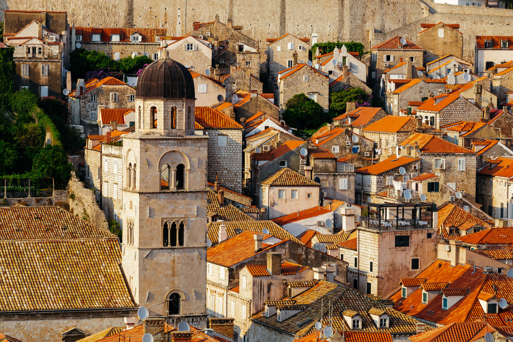 77089327 - franciscan monastery and museum in the background of roofs with tiles in dubrovnik, croatia.