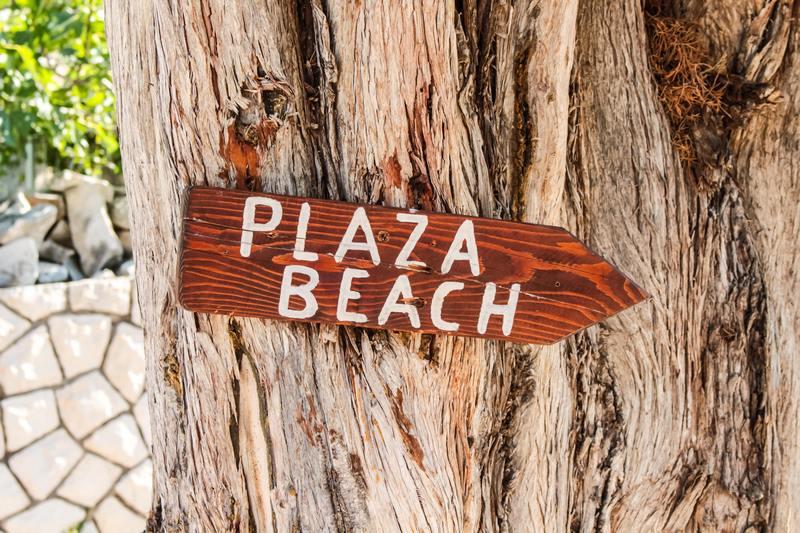 Wooden beach sign in Sumartin town, Brach island, Croatia Dubrovnik Chasing the Donkey